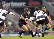 2004_'The Gartmore Challenge' - Barbarians_vs_New-Zealand..Ma'a Nonu look's at the gap, for an attacking option, between Bill Young [left] and Brenan Cannon..04.12.2004 Photo  Peter Spurrier. .email images@intersport-images.com...