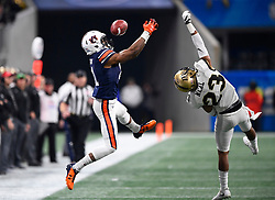 Auburn Tigers wide receiver Darius Slayton (81) misses an intended reception under pressure from UCF Knights defensive back Tre Neal (23) during the second half of the Chick-fil-A Peach Bowl NCAA college football game at Mercedes-Benz Stadium January 1, 2018, in Atlanta. UCF won 34-27 to go undefeated for the season. (David Tulis via Abell Images for Chick-fil-A Peach Bowl)