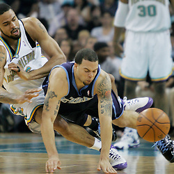 New Orleans Hornets center Tyson Chandler #6 swats the ball away for Utah Jazz guard Deron Williams #8 in the second quarter of their NBA game on April 8, 2008 at the New Orleans Arena in New Orleans, Louisiana.