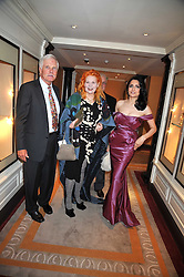 Left to right, TED TURNER, DAME VIVIENNE WESTWOOD and RENU MEHTA founder of Fortune Forum at the 3rd Fortune Forum Summit held at The Dorchester Hotel, Park Lane, London on 3rd March 2009.