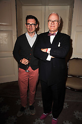 Left to right, ERDEM MORALIOGLU and MANOLO BLAHNIK at a dinner hosted by Vogue in honour of photographer David Bailey at Claridge's, Brook Street, London on 11th May 2010.