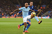 Manchester City midfielder Fabian Delph (18) battles with Leicester City midfielder Vicente Iborra (21) during the Premier League match between Leicester City and Manchester City at the King Power Stadium, Leicester, England on 18 November 2017. Photo by Jon Hobley.