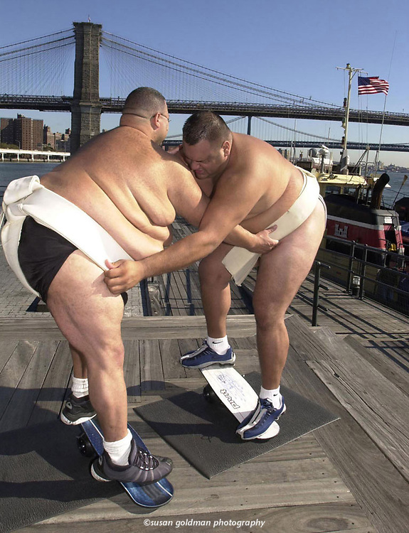 North American Sumo Champion James Perry, left, weighing in at 525 pounds, battles Alex Vega, 450 pounds, a member of the U.S. Sumo National team, as they balance on a Pivit at the South Street Seaport in lower Manhattan, in New York. The Pivit, a new breed of balance board that simulates extreme board sports, has a single wheel in the middle that allows riders to safely practice tricks and techniques for all board sports. Photo/Pivit, Susan Goldman.