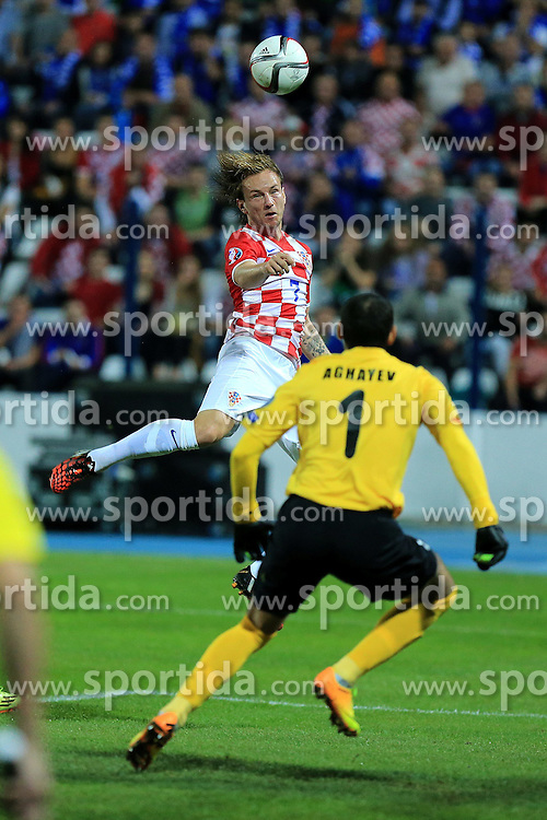 13.10.2014, Stadion Gradski vrt, Osijek, CRO, UEFA Euro Qualifikation, Kroatien vs Aserbaidschan, Gruppe H, im Bild Ivan Rakitic, Kamran Agayev // during the UEFA EURO 2016 Qualifier group H match between Croatia and Azerbaijan at the Stadion Gradski vrt in Osijek, Croatia on 2014/10/13. EXPA Pictures © 2014, PhotoCredit: EXPA/ Pixsell/ Davor Javorovic<br /> <br /> *****ATTENTION - for AUT, SLO, SUI, SWE, ITA, FRA only*****