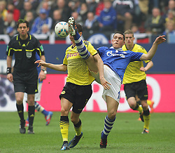 14.04.2012, Veltins Arena, Gelsenkirchen, GER, Schalke 04 vs Borussia Dortmund, 31. Spieltag, im Bild v.l. Robert Lewandowski (Borussia Dortmund), Kyriakos Papadopoulos (FC Schalke 04), Aktion // during the German Bundesliga Match, 31th Round between Schalke 04 and Borussia Dortmund at the Veltins Arena, Gelsenkirchen, Germany on 2012/04/14. EXPA Pictures © 2012, PhotoCredit: EXPA/ Eibner/ Alexander Neis..***** ATTENTION - OUT OF GER *****