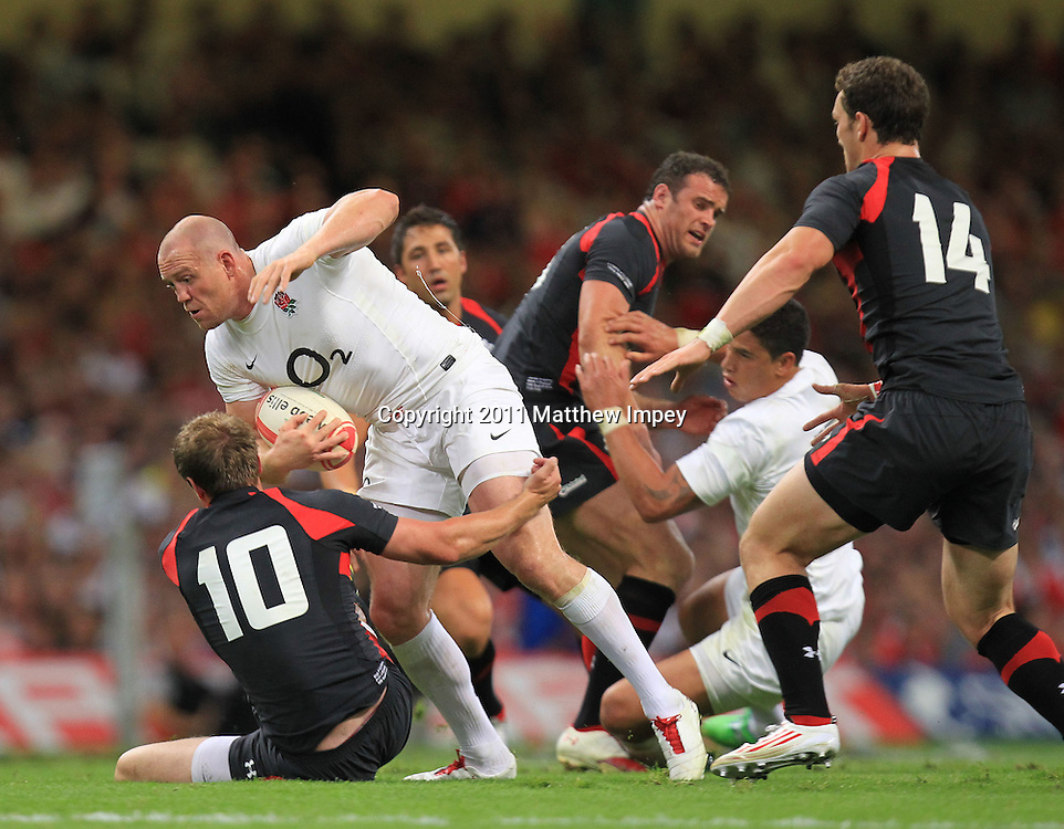 Mike Tindall of England is tackled by Rhys Priestland of Wales. Wales v England, Millennium Stadium, Cardiff, Rugby Union, 12/08/2011 © Matthew Impey/Wiredphotos.co.uk. tel: 07789 130 347 email: matt@wiredphotos.co.uk