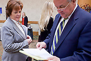 23 February 2009 -- PHOENIX, AZ:  COLLEEN JAMMER, from Phoenix, talks to PAUL ROSELE, from Tempe, a Distract Manager at American Republic Insurance during a job fair sponsored by National Career Fairs in the Marriott Hotel in Phoenix Monday. Jammer said her current job in the construction industry will probably be eliminated in the next three weeks. More than 1,500 people lined up for a chance to turn in a resume and be interviewed by the 21 firms who had booths at the job fair. According to the US Bureau of Labor Statistics, unemployment in Arizona increased from 3.9 percent in April 2008 to 6.9 percent in December 2008.    Photo By Jack Kurtz / ZUMA Press