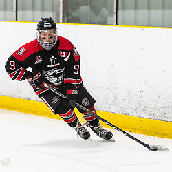 TORONTO, ON - APR 10, 2018: Ontario Junior Hockey League, South West Conference Championship Series. Game seven of the best of seven series between the Georgetown Raiders and the Toronto Patriots, Jordan Crocker #9 of the Georgetown Raiders rounds the boards and skates with the puck during the third period.<br /> (Photo by Kevin Raposo / OJHL Images)