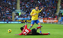 Arsenal's Mesut Ozil is tackled by Cardiff City's Kevin Theophile Catherine - Photo mandatory by-line: Gary Day/JMP - Tel: Mobile: 07966 386802 30/11/2013 - SPORT - Football - Cardiff - Cardiff City Stadium - Cardiff City v Arsenal - Barclays Premier League