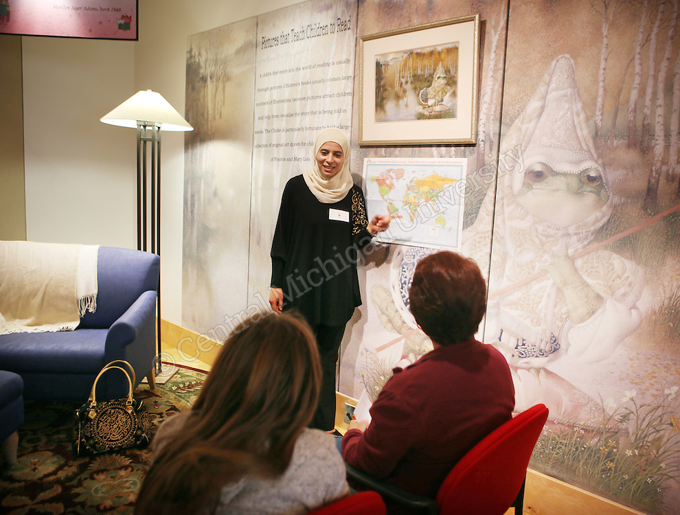 Graduate student Duha Hamed points to the country of Jordan which is where she is from during the International Children's Book Read In photo by Emily Mesner
