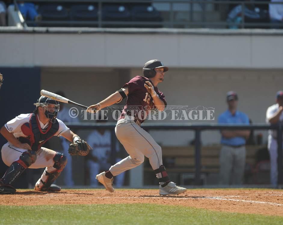 Mississippi State's Adam Frazier drives in two runs with a hit as Mississippi catcher Stuart Turner watches the action at Oxford-University Stadium in Oxford, Miss. on Sunday, May 12, 2013. Mississippi State won 7-6. (AP Photo/Oxford Eagle, Bruce Newman)