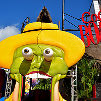 """CoCo Bongo at Party Zone in Cancun, Mexico <br /> Fans of the 1994 movie """"The Mask"""" will immediately recognize this garish, green-faced character played by Jim Carrey at the CoCo Bongo nightclub, owned by his archenemy, the gangster Dorian Tyrell. This less-than-subtle marque only hints at the entertainment inside of this bar and disco at Plaza Forum. The highlight is the acrobatic show featuring movie favorites who fly and gyrate among heart-pounding music, a bedazzling lightshow, fluttering confetti and theater smoke. This is a rocking good time!"""