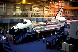 Stock photo of a space shuttle sitting in an indoor NASA hangar in Houston Texas