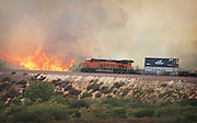 August 16, 2016 - Rancho Cucamonga, California, U.S. - <br /> <br /> A freight train in the Cajon Pass is threatened by a brush fire burning north of the I-15 and I-215 junction near Devore on Tuesday.<br /> ©Exclusivepix Media