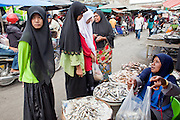 """Sept. 26, 2009 -- YALA, THAILAND: Muslim women buy fish in the market in Yala, Thailand. Thailand's three southern most provinces; Yala, Pattani and Narathiwat are often called """"restive"""" and a decades long Muslim insurgency has gained traction recently. Nearly 4,000 people have been killed since 2004. The three southern provinces are under emergency control and there are more than 60,000 Thai military, police and paramilitary militia forces trying to keep the peace battling insurgents who favor car bombs and assassination.  Photo by Jack Kurtz / ZUMA Press"""