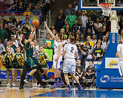 Huntington guard Tavian Dunn-Martin (11) is fouled against Parkersburg South during the Class AAA championship game at the Charleston Civic Center.