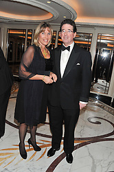 LORD GRIMTHORPE and EMMA BENYON at the 22nd Cartier Racing Awards held at The Dorchester, Park Lane, London on 13th November 2012.