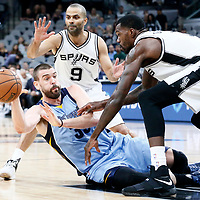 04 April 2017: San Antonio Spurs center Dewayne Dedmon (3) and San Antonio Spurs guard Tony Parker (9) tries to steal the ball from Memphis Grizzlies center Marc Gasol (33) during the San Antonio Spurs 95-89 OT victory over the Memphis Grizzlies, at the AT&T Center, San Antonio, Texas, USA.
