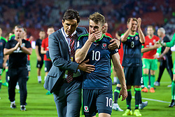 BELGRADE, SERBIA - Sunday, June 11, 2017: Wales' manager Chris Coleman with Aaron Ramsey after the 1-1 draw against Serbia during the 2018 FIFA World Cup Qualifying Group D match between Wales and Serbia at the Red Star Stadium. (Pic by David Rawcliffe/Propaganda)