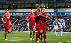 29.10.2011, The Hawthorns, West Bromwich, ENG, PL, West Bromwich Albion vs FC Liverpool, im Bild Liverpool's Charlie Adam celebrates scoring the first goal against West Bromwich Albion from the penalty spot with team-mate Glen Johnson, Jordan Henderson and Andy Carroll during the Premiership match at The Hawthorns // during the Premier League match between West Bromwich Albion vs FC Liverpool, at the Hawthorns, West Bromwich, United Kingdom on 29/10/2011. EXPA Pictures © 2011, PhotoCredit: EXPA/ Propaganda Photo/ Vegard Grott +++++ ATTENTION - OUT OF ENGLAND/GBR+++++