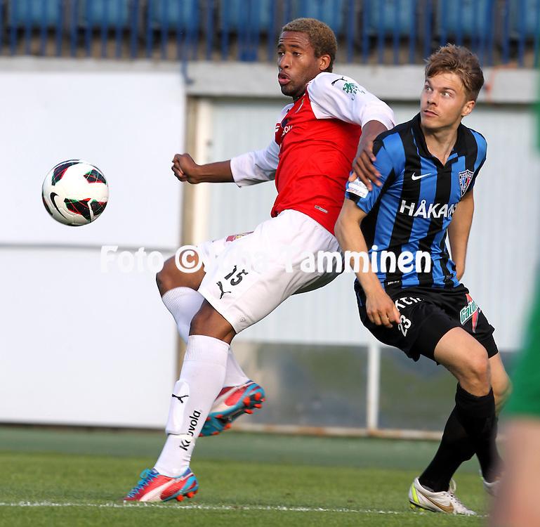 16.6.2013, Veritas Stadion, Kupittaa, Turku.<br /> Veikkausliiga 2013.<br /> FC Inter Turku - Myllykosken Pallo-47.<br /> Jonathan Okafor (MYPA) v Ville Nikkari (Inter).