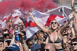 i© Licensed to London News Pictures. 07/07/2018. Brighton, UK. Football fans on the sea front in Brighton celebrate England's 2-0 quarter-final win over Sweden at the Russian World Cup. Photo credit: Peter Macdiarmid/LNP