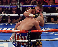 LAS VEGAS, NEVADA - JUNE 15:  Boxer Tom Schwarz(R) hits Tyson Fury during their fight at the MGM Grand Garden Arena on June 15, 2019 in Las Vegas, Nevada. Tyson Fury took the win by TKO after the fight was stop in the second round. MB Media