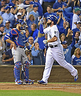 Oct 23, 2015; Kansas City, MO, USA; Kansas City Royals third baseman Mike Moustakas (8) reacts after hitting a solo home run against the Toronto Blue Jays in the second inning in game six of the ALCS at Kauffman Stadium. Mandatory Credit: Peter G. Aiken-USA TODAY Sports