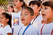 "June 13 - PHOENIX, AZ: A children's choir performs at an immigrants' rights rally and vigil at the Arizona State Capitol Sunday. About 40 immigrants' rights activists from Anaheim, California, joined Phoenix area activists at the Arizona State Capitol Sunday for a prayer vigil and rally against SB 1070, the Arizona law that gives local law enforcement agencies the power to ask to see proof of immigration status in the course of a ""lawful contact"" and when ""practicable."" Immigrants' rights and civil rights activist say the bill will lead to racial profile. Proponents of the bill say it is the toughest local anti-immigration bill in the country and merely brings state law into line with federal immigration law.  The law, which was signed by the Arizona Governor in April, goes into effect on July 29, 2010.   Photo by Jack Kurtz"