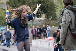 © Licensed to London News Pictures . 03/10/2015 . Manchester , UK . A woman dances as protesters against the Conservative government's policies hold a non-stop rave in Piccadilly Gardens in Manchester City Centre ahead of the Conservative Party's annual conference . Photo credit: Joel Goodman/LNP