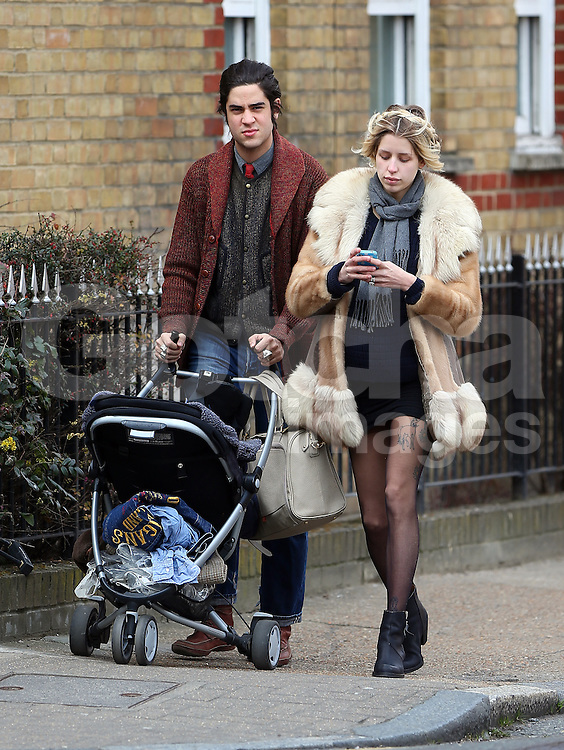 Pregnant Peaches Geldof and husband Thomas Cohen out with their son Astala in London. Peaches with her hair in platts and wearing a fur coat, blue jumper, short black skirt, black tights and ankle boots is due to give birth later this year... UK. 08/04/2013<br />