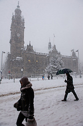 Commuters going to work during a blizzard in Sheffield City center