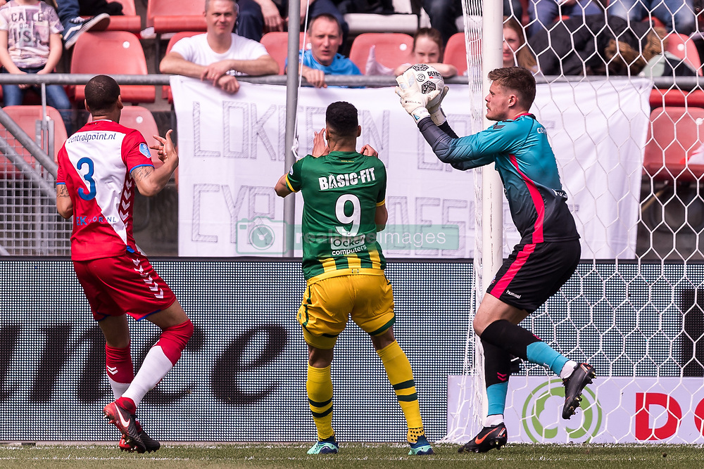 (L-R) Ramon Leeuwin of FC Utrecht, Bjorn Johnsen of ADO Den Haag, goalkeeper David Jensen of FC Utrecht during the Dutch Eredivisie match between FC Utrecht and ADO Den Haag at the Galgenwaard Stadium on April 08, 2018 in Utrecht, The Netherlands