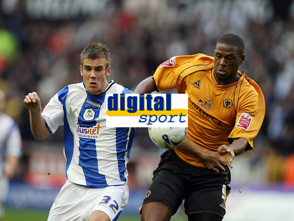 Photo: Rich Eaton.<br /> <br /> Wolverhampton Wanderers v Sheffield Wednesday. Coca Cola Championship. 28/10/2006. Tommy Spurr left of Wednesday and Carl Cort of Wolves go for the ball