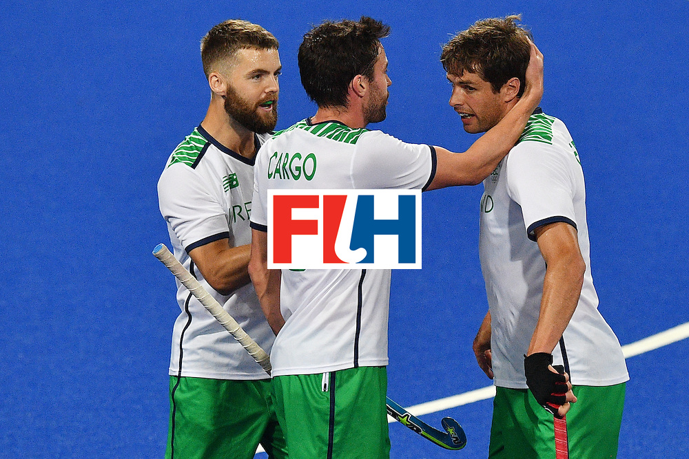 Ireland's John Jermyn (R) celebrates scoring a goal with his teammates during the mens's field hockey Ireland vs Argentina match of the Rio 2016 Olympics Games at the Olympic Hockey Centre in Rio de Janeiro on August, 12 2016. / AFP / Carl DE SOUZA        (Photo credit should read CARL DE SOUZA/AFP/Getty Images)