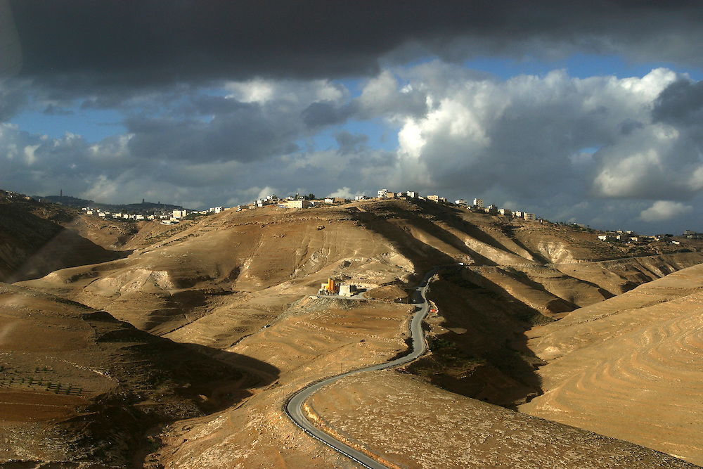 A settlement sits on top of a hill on the road to Jerusalem from Bethlehem.