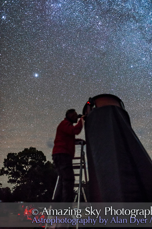 An observer, David Battigal, at the 2017 OzSky Star Party in Australia aims one of the large Dobsonain telescopes at a target in the southern Milky Way.