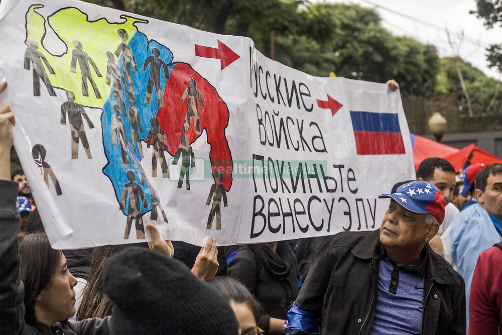 April 30, 2019 - Buenos Aires, Federal Capital, Argentina - This Tuesday, April 30, Venezuelan migrants residing in the city of Buenos Aires moved to the Venezuelan Embassy in the Capital City to express their support for the leaders of the Venezuelan opposition, Juan Guaidó and Leopoldo Lopez, at the same time they made strong confrontations in the Venezuelan capital. The Venezuelan Embassy in La Ciudad Porteña also presented leftist organizations and sympathizers of Nicolas Maduro who repudiated the events that took place in Venezuela. (Credit Image: ©  Roberto Almeida Aveledo/ZUMA Wire)