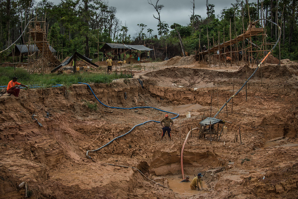 LAS CLARITAS, VENEZUELA - MAY 26, 2016:  Thousands of Venezuelans are flocking to illegal gold mines, like this one in hopes of surviving the current economic crisis by earning in gold instead of the national currency, whose value steadily falls due to the world's highest inflation.  From this remote part of the jungle the migrant miners have become the vectors of a new epidemic of malaria, because the hot, swampy conditions of the mines make for an ideal breeding ground for mosquitos. Miners spread the disease as they return home with earnings or pay visits to family members.  The economic crisis has also left the government without the financial resources to control the disease - they are unable to fumigate homes, provide medicines to everyone that is sick, or even to test all patients with symptoms of malaria in many places. PHOTO: Meridith Kohut for The New York Times