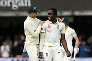 Wicket - Jofra Archer of England celebrates taking the wicket of Usman Khawaja of Australia is congratulated by Joe Root of England during the International Test Match 2019 match between England and Australia at Lord's Cricket Ground, St John's Wood, United Kingdom on 18 August 2019.
