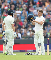 England's Jos Buttler checks his helmet after being hit from the bowling of Pakistan's Hasan Ali during day two of the Second Natwest Test match at Headingley, Leeds.