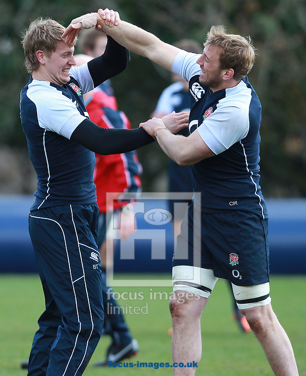Picture by Paul Terry/Focus Images Ltd +44 7545 642257.14/03/2013.Billy Twelvetrees ( L ) and Chris Robshaw pictured warming up during England Training at Pennyhill Park, Bagshot.