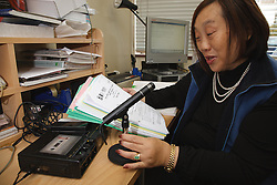 Woman who has long-term illness and reduced mobility following a car accident, helped into employment by the Ready 4 Work team, Nottinghamshire County Council, recording into tape recorder
