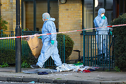 © Licensed to London News Pictures. 12/01/2020. London, UK. Police forensic officers at the crime scene in Upper North Street in Tower Hamlets, where a teenage boy with stab injuries to his chest was discovered and taken to an east London hospital at 3. 30am this morning where he remains in a life threatening condition. A 15-year-old boy has been arrested and taken into custody. Photo credit: Vickie Flores/LNP