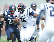 Jeremy Liggins (15) scrambles during Mississippi's Grove Bowl controlled scrimmage at Vaught-Hemingway Stadium in Oxford, Miss. on Saturday, April 5, 2014. (AP Photo/Oxford Eagle, Bruce Newman)
