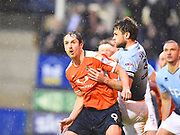 Luton Town player Danny Hylton wrestle with a Blackpool defender in the first half during the EFL Sky Bet League 2 play off second leg match between Luton Town and Blackpool at Kenilworth Road, Luton, England on 18 May 2017. Photo by Ian  Muir.