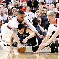 25 April 2016: Portland Trail Blazers guard Damian Lillard (0) and Portland Trail Blazers center Mason Plumlee (24) vie for the loose ball with Los Angeles Clippers guard Austin Rivers (25) during the Portland Trail Blazers 98-84 victory over the Los Angeles Clippers, during Game Four of the Western Conference Quarterfinals of the NBA Playoffs at the Moda Center, Portland, Oregon, USA.