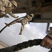 Camp Lemonier, Djibouti (July 12, 2006) - U.S. Marines from the 4th Provisional Security Company conduct advanced fast rope training from a CH-53 Super Stallion assigned to Marine Heavy Helicopter Squadron Four Six One (HMH-461) at Chebelley Airfield. U.S. Navy Photo by Mass Communication Specialist 2nd Class Roger S. Duncan (RELEASED)