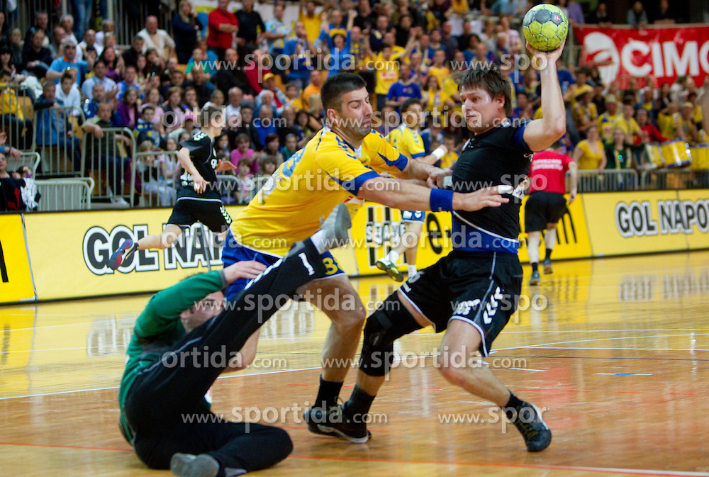Darko Stanic and Vladimir Osmajic of Koper vs Marko Bezjak of Gorenje during handball match between RK Cimos Koper and RK Gorenje Velenje of 1st Slovenian league, on April 20, 2011 in Arena Bonifika, Koper, Slovenia. (Photo By Vid Ponikvar / Sportida.com)