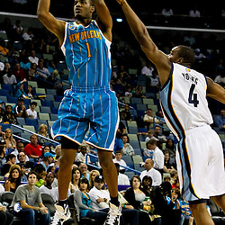 October 9, 2010; New Orleans, LA, USA; New Orleans Hornets small forward Trevor Ariza (1) shoots over Memphis Grizzlies forward Sam Young (4) during the second half of a preseason game at the New Orleans Arena.The Grizzlies defeated the Hornets 97-90. Mandatory Credit: Derick E. Hingle